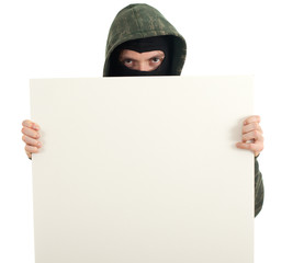 male thief in mask and hood with blank sign, billboawd