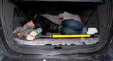 kidnapped for ransom - tied woman in boot of car