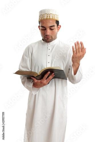 Teacher or Preacher reading from a book