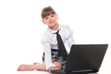 Attractive little girl with laptop