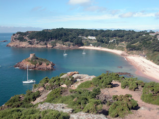 Yachts moored in the sandy cove of Portelet Bay, Jersey