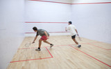 Fototapety Squash players in action on a squash court (motion blurred image