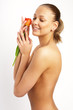 Fashion photo of young sensual woman with the tulip.