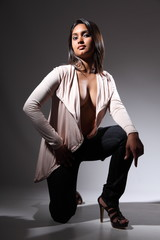 Voluptuous fashion model in sexy kneeling pose