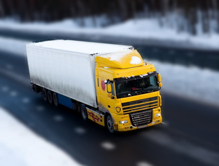 Truck on road with motion blur