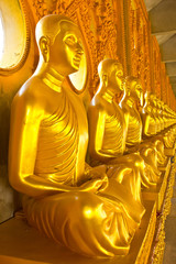 Golden monk statues in Mahajadee Chaimongkol temple