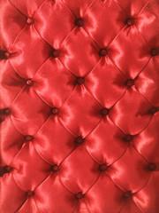 fond capitonnage en satin rouge