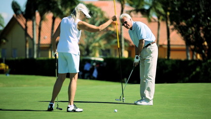 Mature Couple Enjoying the Golf Course