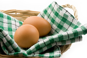 Fresh eggs in a woven basket