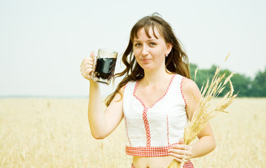 Girl  with beer and wheat ears