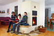 family sitting on the bench of a masonry stove 02