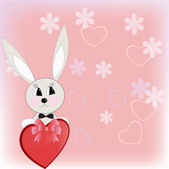 The toy rabbit holds heart