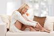 Sorrowful blondie woman on the sofa