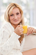 Beauty, blondie woman with a glass of orange juice