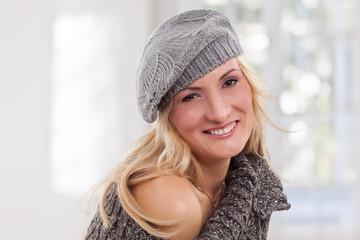 Beauty, blondie woman wear a grey-colored hat
