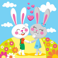 Sweet bunny couple holding hands walking between flowers