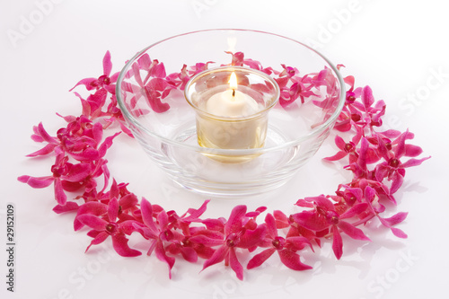 red orchid circle with bowl and candle