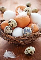 Eggs in a  nest on a wooden table