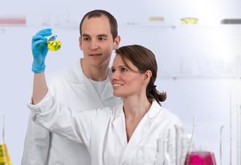 Caucasian biotechnicians in the lab