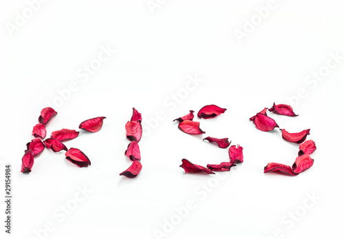 'kiss' written with flower petals