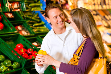 Couple in supermarket shopping groceries