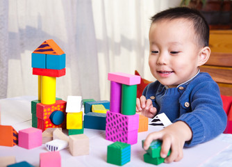 kid with toy blocks