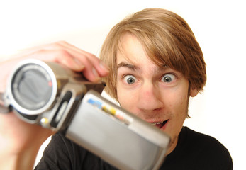 Young adult with camcorder