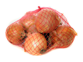 Onions in a net isolated on white