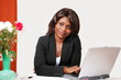 Sincere african woman in office