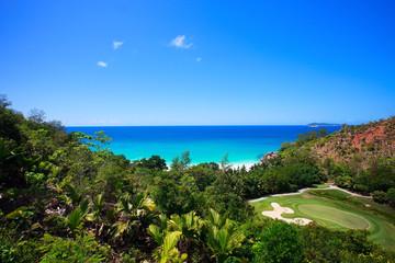 Tropical beach and golf field