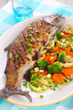 Grilled fish with vegetables (carrots, broccoli, zucchini)