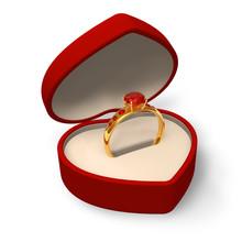 Hjärtformade låda med guldring med juveler