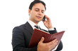 Businessman talking at the phone while holding his agenda