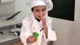 child holding a broccoli