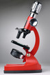 red microscope on gray background