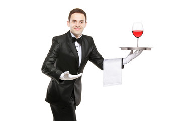 Waiter holding a silver tray with a glass of wine on it