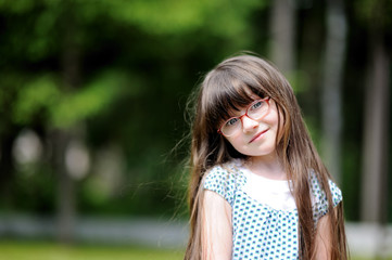 Spring Portrait of adorable little girl with long dark hair
