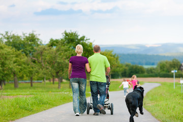 Family with children and dog having walk