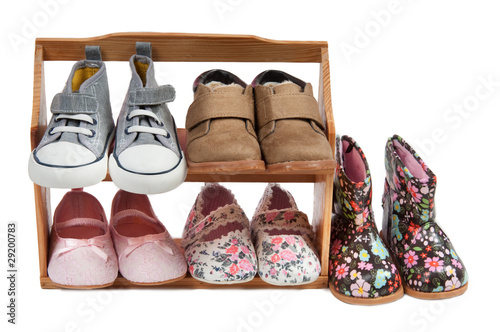 Shelf of children shoes for all occasions isolated on white