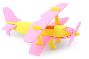 airplane yellow and pink toy isolated on white