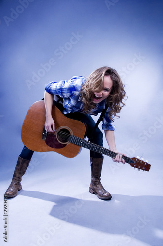 Emothional girl with guitar.