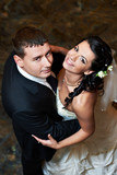 Fototapety Romantic embrace bride and groom in wedding dance