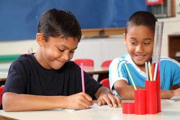 Two school boys enjoying their learning in class