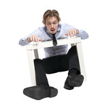 Young businessman, office worker or student sitting at funny sma poster