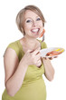 pregnant woman eats smoked salmon
