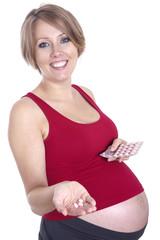 Pregnant woman holding medicine
