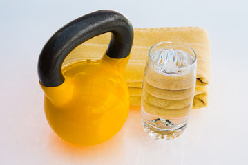 Kettlebell with towel and glass of water