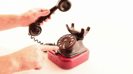 retro phone ringing on white background
