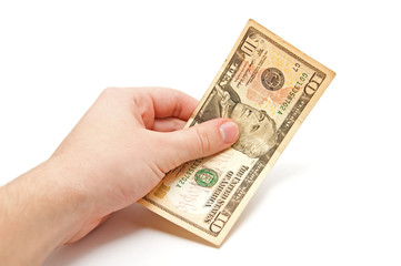 Hand holds a 10 dollar bill
