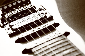 Close-up of electric guitar body, strings and string pickups